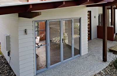 Essential French doors (open in screens N/A) with full height double hung side lites (without screens)