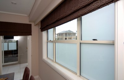 "Essential double hung window with ""white translucent laminated glass"" (52mm frame)"