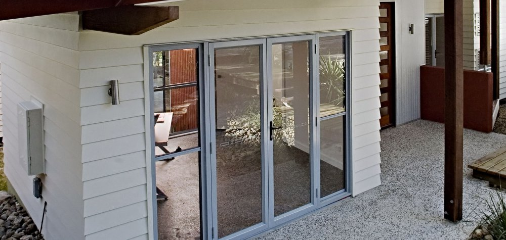 Essential open out hinged door with Essential double hung sidelites (screen doors not available for open out doors)